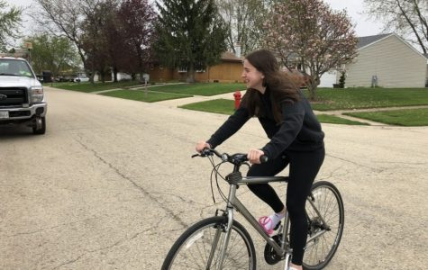 Freshman Claire Gieseke rides her bike to stay active while at home.