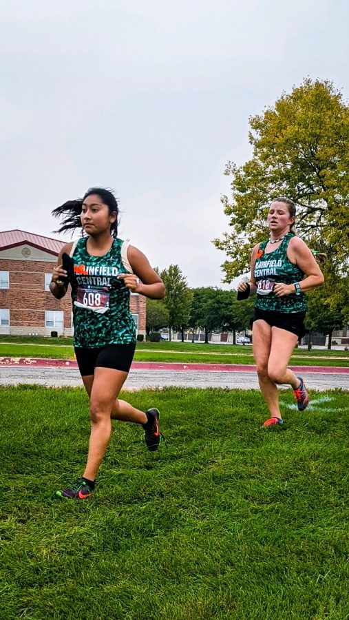 Seniors Denise Herrera-Ojeda and Lillian Pankhurst sprint off in the Open Race at Joliet West on Sept. 26.