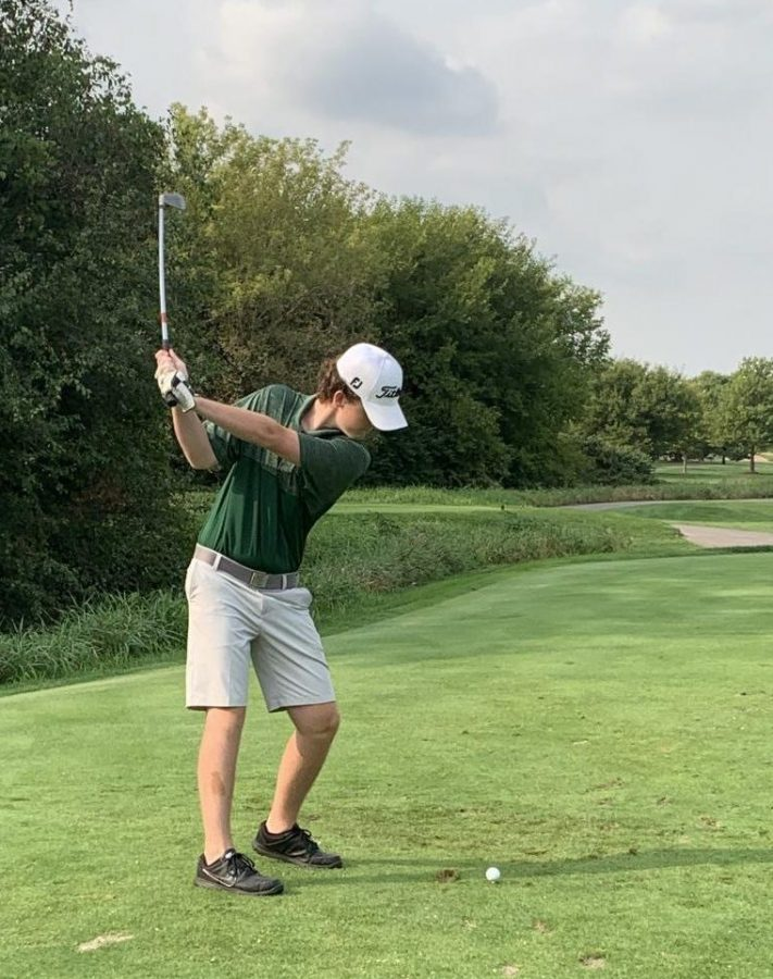 Senior Jake Ramey winds up to drive the ball down the fairway.