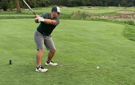 Senior Max Hunter winds up to hit the ball