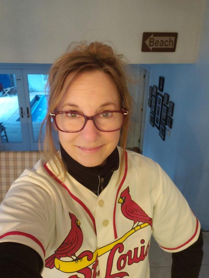 Deb Pohlmann, science teacher, proudly displays her Cardinals jersey
