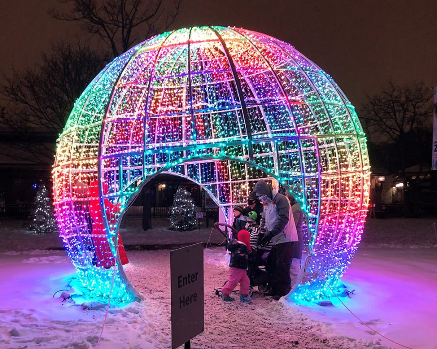Families take photos inside the multi-colored sphere at Brookfield Zoo.