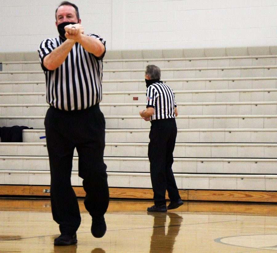 Referee calls a foul on Plainfield East as Plainfield Central leads with a score of 37-11 leading into third quarter.