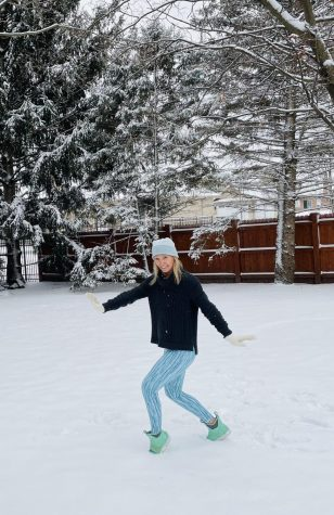 Dance teacher Bridget Taylor demonstrates dancing in the snow.