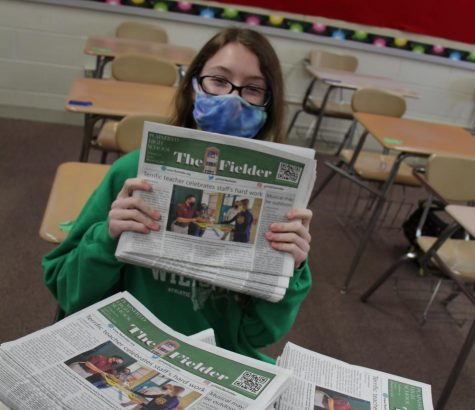 Junior Nicole Jones displays the first print edition of the Fielder for this school year.