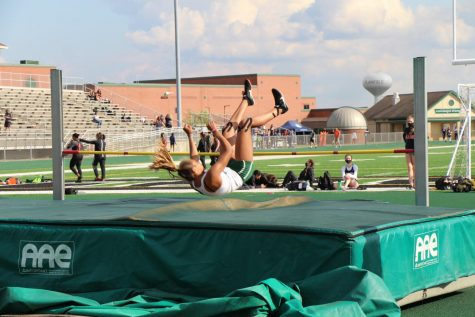 Tess Foster, junior, clears the bar in high jump at the Hunt Invitation.