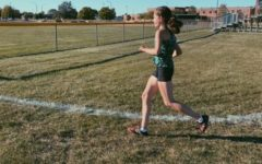 Senior Reilly Rossi finishes her second mile with one more to go!