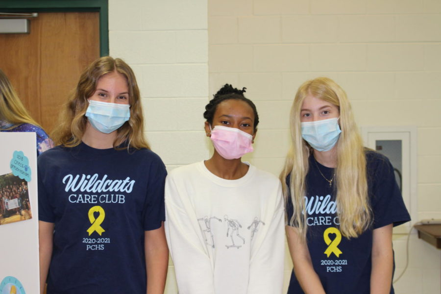 (Left to right) Emma Romberg, Kayln Jackson, and Lily Romberg represent Wildcat Care Club.