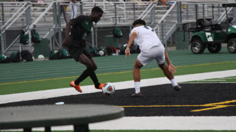 Moses Mata, senior, dribbles around a  defender in the Wildcats 2-2 tie vs. Plainfield South on Sept. 14.
