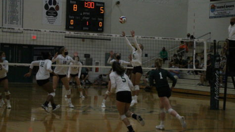 Jenny Shook, senior, sets up a spike to help the Wildcats in their three-set victory over Lockport on Sept. 14.
